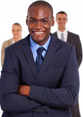 handsome african american businessman in front of team