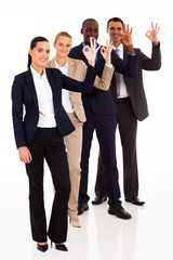 group of business people giving ok hand sign