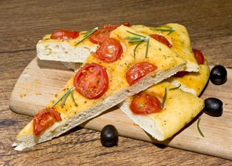 Focaccia with tomato  and black olives