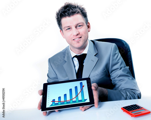 Smiling businessman holding digital tablet with positive busines