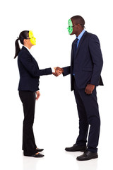 two business people with mask handshaking full length on white