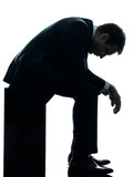 sad business man sitting pensive silhouette