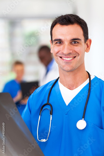 cheerful medical doctor with x-ray