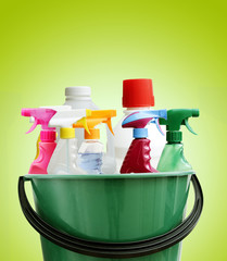 Cleaning bottles in bucket