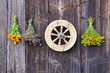 vintage wooden wheel and medical herbs bunch