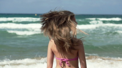 Woman with beautiful hair by the sea, super slow motion