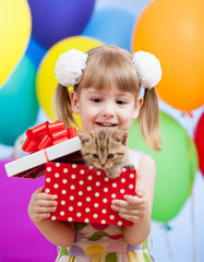 kid girl with colorful balloons and kitten in gifting box