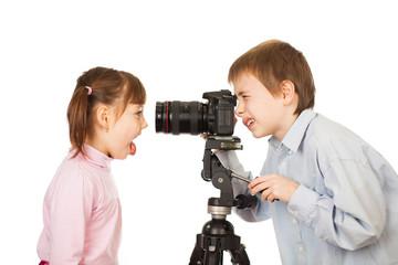 Boy photographing girl