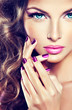 beautiful model with curly hair and purple manicure