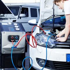 Car mechanic checking the air handling unit of a car