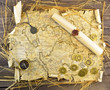 Pirate map with coins and scroll
