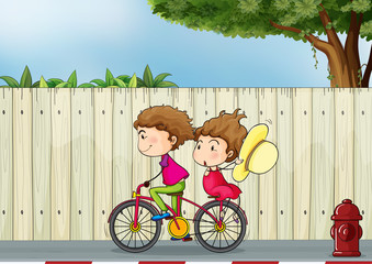 A girl and a boy biking