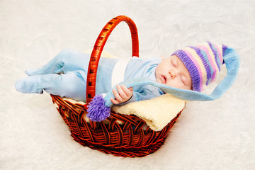 Newborn baby in blue knitted cap