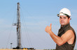 oil worker with thumb up