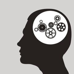 Cogs or gears in human head.