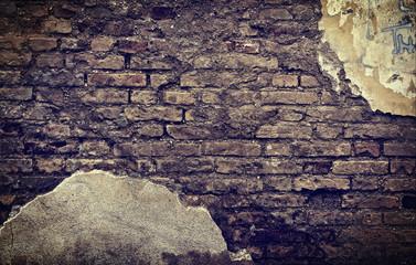 muro di mattoni con intonaco