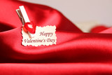 Greeting card for Valentine's Day, on red satin