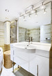 Wash stand with mirror in modern white bathroom interior