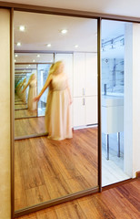 Mirror wardrobe in modern hall interior with infinity reflection