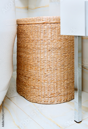 Wicker clothes basket in the bathroom, interior detail