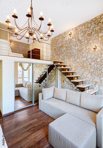 Modern style two-high living-room interior with staircase and st
