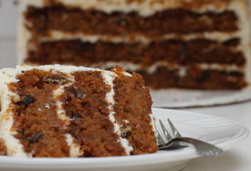 Slice of Carrot Cake on Plate with Fork