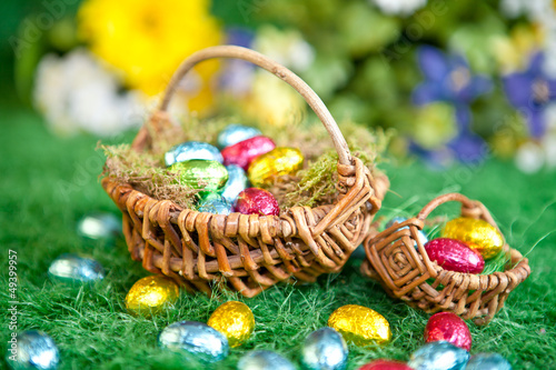 canvas print picture Easter nest with easter nest on green