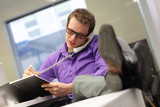 businessman on phone - bad sitting posture