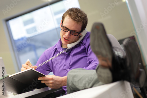 businessman on phone - bad sitting posture