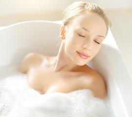 Attractive girl relaxing in bath