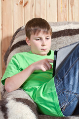 boy teenager with tablet computer