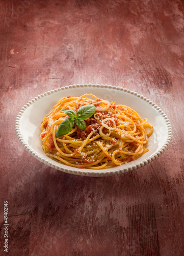 spaghetti with tomato sauce and parmesan cheese