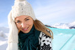 Portrait of beautiful woman in snowy mountain
