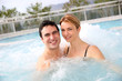 Couple enjoying in spa center