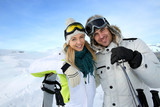 Cheerful couple enjoying winter vacation