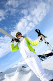 Portrait woman skier standing on snowy mountain