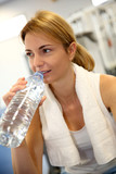 Portrait of fitness girl drinking water