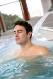 Man relaxing in massage pool
