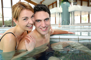 Couple enjoying bathtime in spa resort