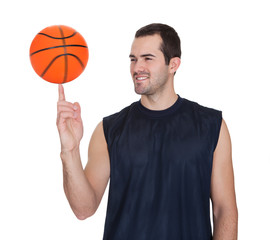 Professional basketball player spinning ball