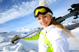 Portrait of cheerful blond woman at ski resort