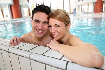 Couple having fun in spa center