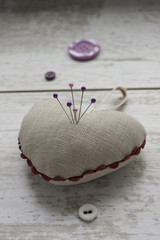 Linen pin-cushion with colored pins