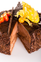 Rich chocolate cake with fruit decoration