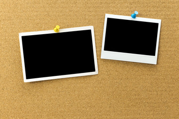 Blank photo frame at the cork board with clipping path