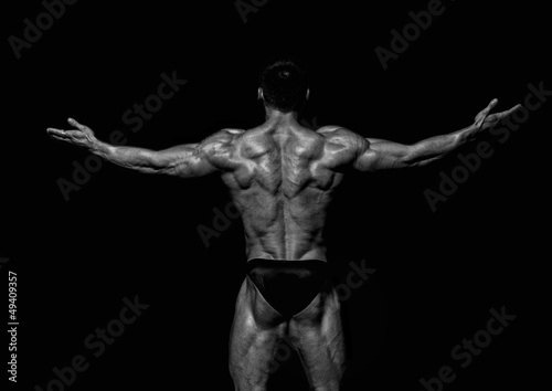Fit male model showing his back