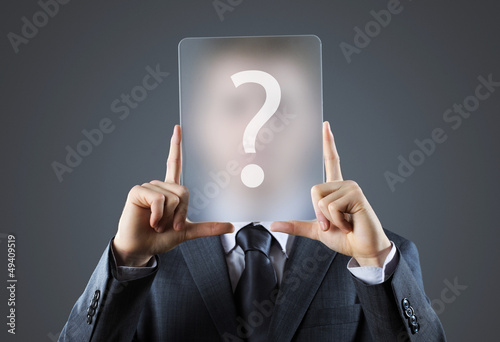 Young business man holding question mark signs