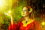 woman fairy in summer magic forest