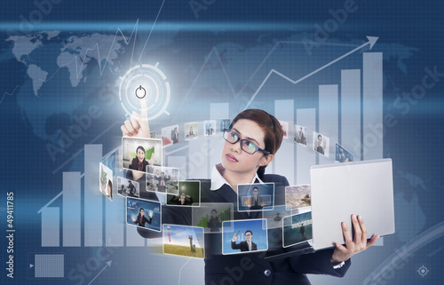 Businesswoman surrounds with digital media