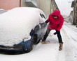 Real woman driver wrestles with snow chains
